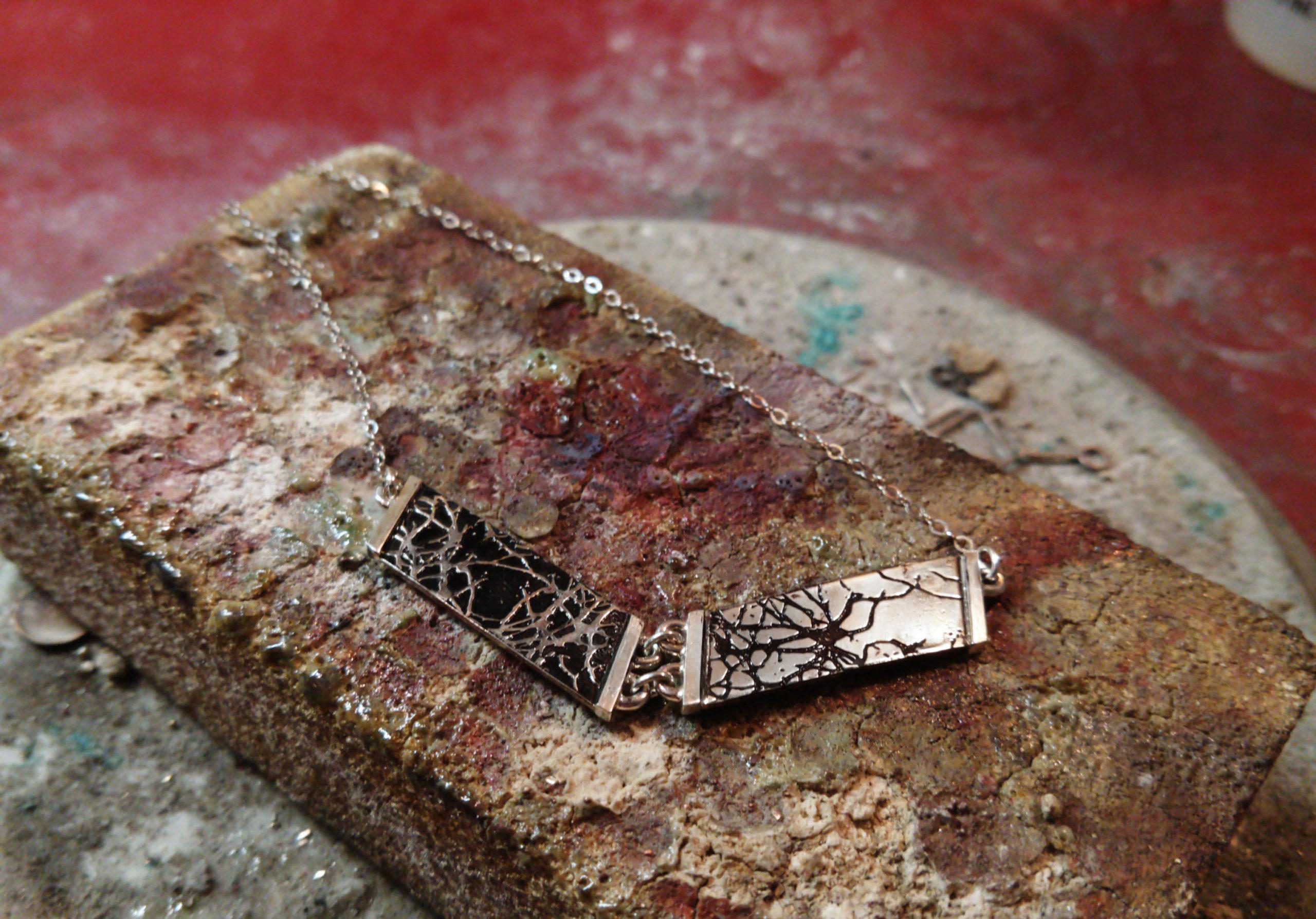 Hinged golgi stain necklace